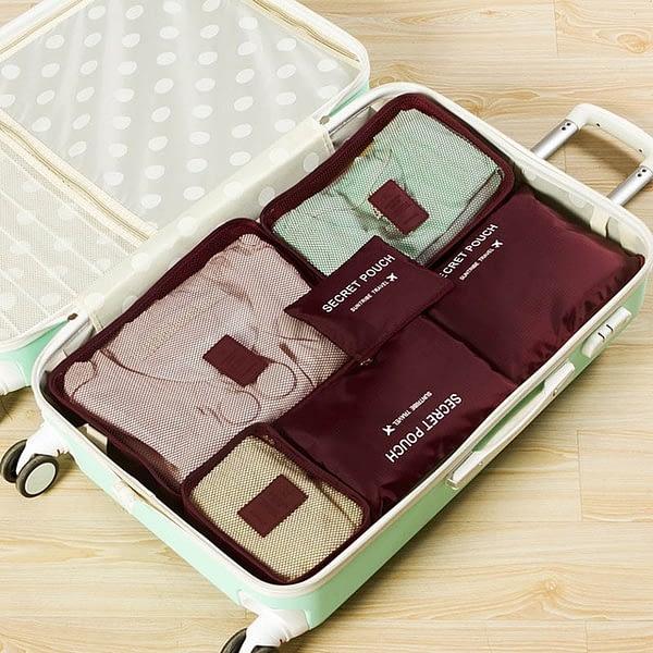 DS-08B Фото чемодана с вещами в бордовом наборе из 6шт. сумочек. Товары для отдыха. Интернет-магазин В Отпуск