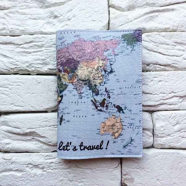 Фото анфас паспортная обложка Lets travel Карта голубая. Коллекция обложек Путешествуй!